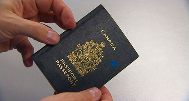 Man holding his Canadian passport